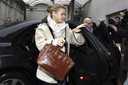 Corinna Schumacher, wife of former Formula One world champion Michael Schumacher, and Professor Gerard Saillant, president of the Institute for Brain and Spinal Cord Disorders (ICM), arrive at the CHU hospital emergency unit in Grenoble
