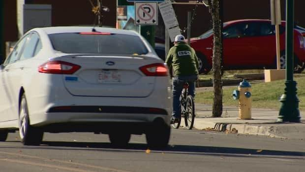 Drivers will now have to make sure there is at least a metre of space to pass cyclists on city streets. (Nathan Gross/CBC - image credit)
