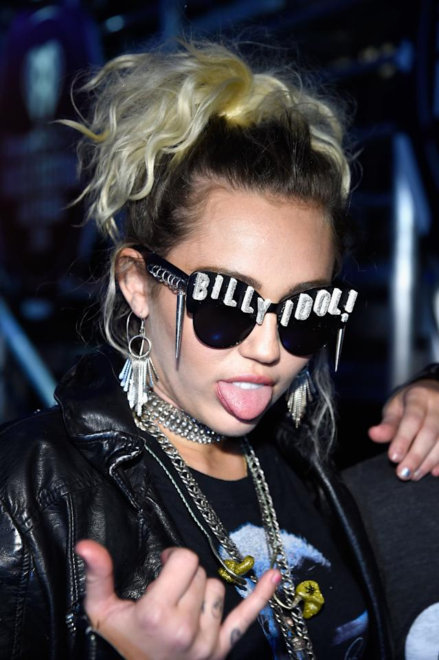 <p>Miley hits the stage at the IHeartRadio Music Festival in a fluffy high ponytail.</p>
