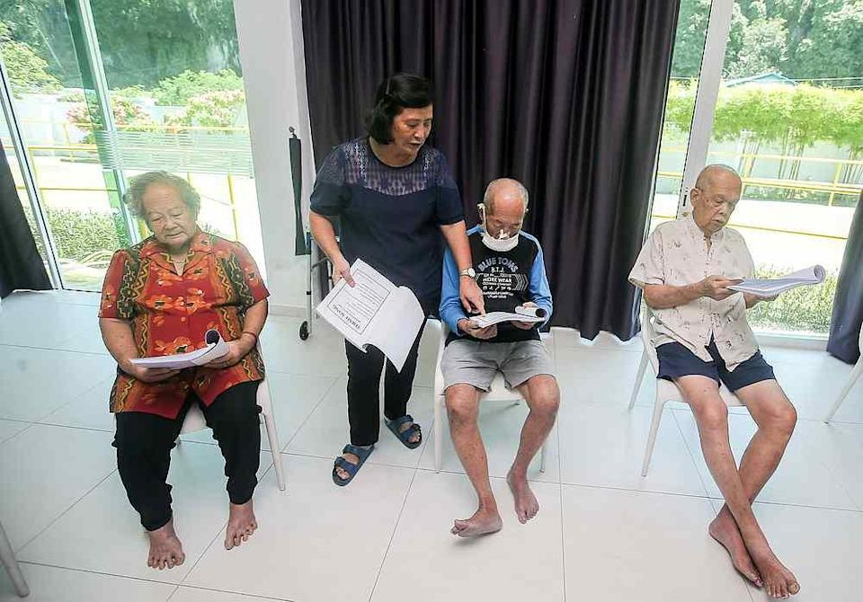 Clients at BebeLEC Day Care Centre for dementia patients have various activities to slow down the progression of the disease. — Picture by Farhan Najib