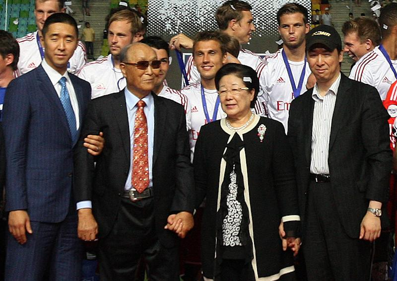 FILE - In this July 22, 2012 file photo, the Rev. Sun Myung Moon, the founder of the Unification Church, second from left, poses with his wife Hak Ja Han Moon, second from right, his sons Hyung-jin Moon, left, and Kook Jin Moon during the closing ceremony of the 2012 Peace Cup Suwon at Suwon World Cup Stadium in Suwon, South Korea. The late Rev. Sun Myung Moon, who died Monday, Sept. 3 at 92, had 13 children with his wife, Hak Ja Han Moon. (AP Photo/Ahn Young-joon, File)