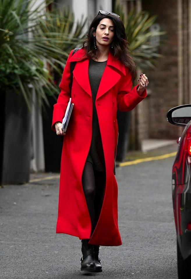 <p></p><p>Photographed for the first time since the world found out her and husband George Clooney are expecting twins, Clooney looked stunning a a bright red coat, motorcycle boots and a simple grey dress. </p><p></p>
