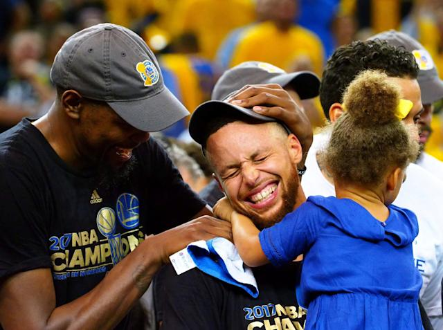 """<a class=""""link rapid-noclick-resp"""" href=""""/nba/players/4244/"""" data-ylk=""""slk:Kevin Durant"""">Kevin Durant</a> and <a class=""""link rapid-noclick-resp"""" href=""""/nba/players/4612/"""" data-ylk=""""slk:Stephen Curry"""">Stephen Curry</a> celebrate after winning the2017 NBA Finals. (USA TODAY Sports)"""