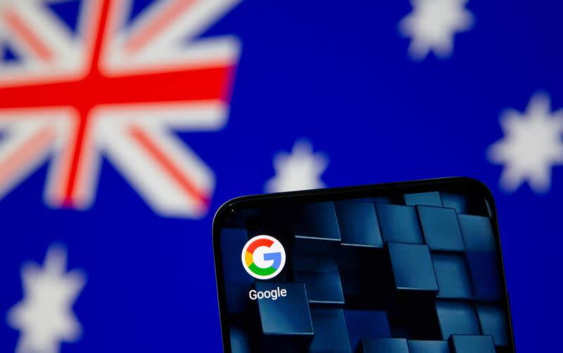 FILE PHOTO: Smartphone with google app icon is seen in front of the displayed Australian flag in this illustration taken