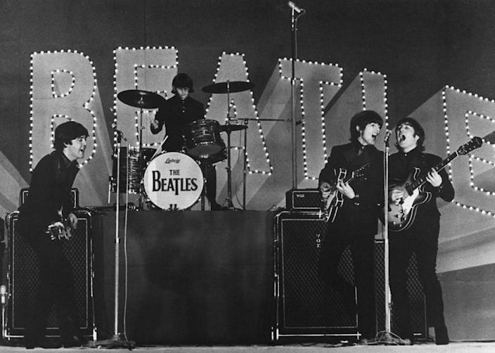"<div class=""inline-image__caption""> <p>The Beatles performing during their concert at the Budokan in Tokyo, Japan, on June 30, 1966. </p> </div> <div class=""inline-image__credit""> Jiji Press/AFP/Getty </div>"