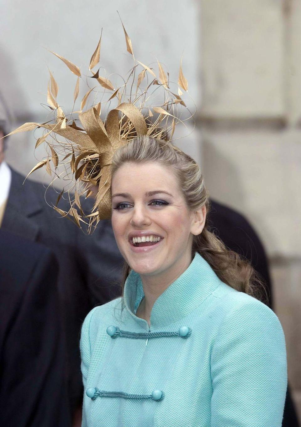 """<p>Camilla's daughter Laura Lopes chose a metallic fascinator to wear to her mother's wedding.</p><p><strong><a href=""""https://www.townandcountrymag.com/society/tradition/a17008420/camilla-parker-bowles-children/"""" rel=""""nofollow noopener"""" target=""""_blank"""" data-ylk=""""slk:More: Meet the Children of Camilla, Duchess of Cornwall."""" class=""""link rapid-noclick-resp"""">More: Meet the Children of Camilla, Duchess of Cornwall.</a></strong><br></p>"""