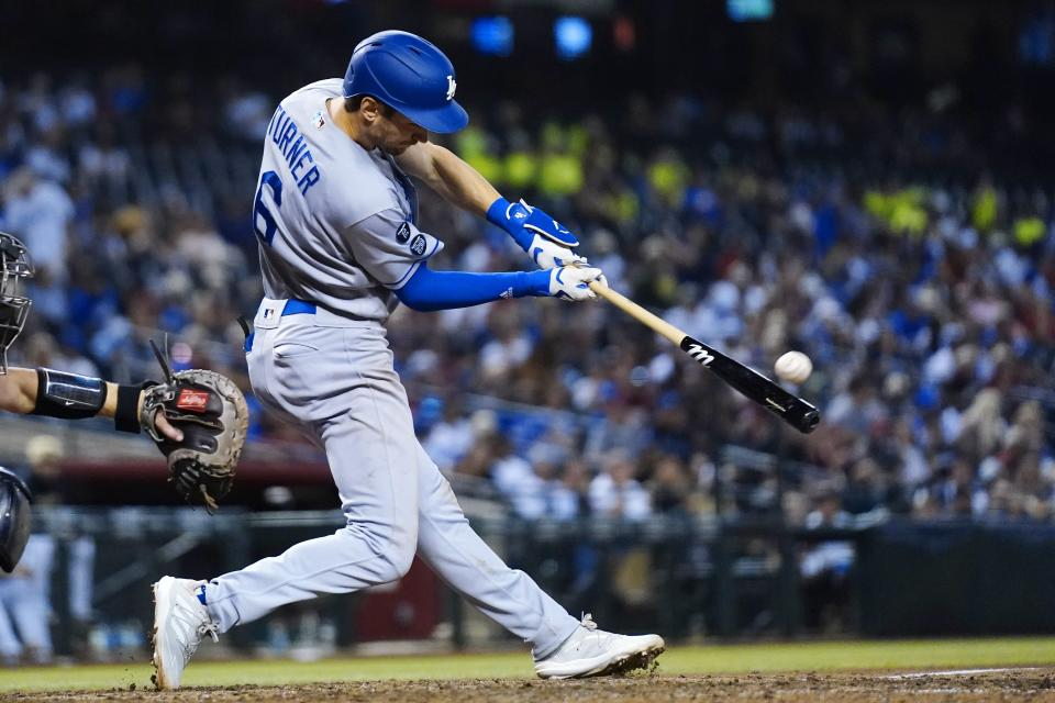 Los Angeles Dodgers Trea Turner connects for a home against the Arizona Diamondbacks during the ninth inning of a baseball game, his second of the game, Saturday, Sept. 25, 2021, in Phoenix. The Diamondbacks defeated the Dodgers 7-2. (AP Photo/Ross D. Franklin)
