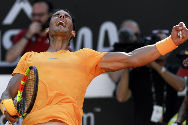 Spain's Rafael Nadal celebrates after winning his semifinal match against Serbia's Novak Djokovic at the Italian Open tennis tournament, in Rome, Saturday, May 19, 2018. Rafael Nadal was challenged in the first set by Novak Djokovic before pulling away for a 7-6 (4), 6-3 win to reach the Italian Open final on Saturday. (AP Photo/Gregorio Borgia)