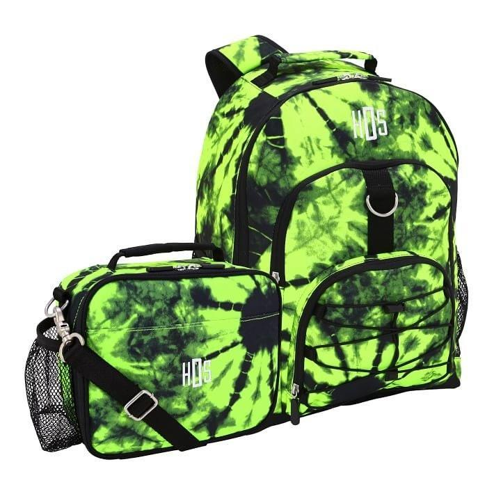 """If this backpack/lunchbox combo doesn't give you serious <a href=""""https://www.teenvogue.com/story/billie-eilish-dyed-roots-neon-green?mbid=synd_yahoo_rss"""" rel=""""nofollow noopener"""" target=""""_blank"""" data-ylk=""""slk:Billie Eilish vibes"""" class=""""link rapid-noclick-resp"""">Billie Eilish vibes</a>, I don't know what will. $94, Pottery Barn Teen. <a href=""""https://www.pbteen.com/products/gear-up-santa-cruz-tie-dye-recycled-backpack-cold-pack-bundle/?pkey=cshop-backpacks-new"""" rel=""""nofollow noopener"""" target=""""_blank"""" data-ylk=""""slk:Get it now!"""" class=""""link rapid-noclick-resp"""">Get it now!</a>"""