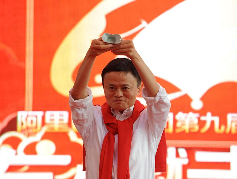 HANGZHOU, CHINA - MAY 09: Jack Ma, chairman of Alibaba Group, witnesses a group wedding ceremony on May 9, 2014 in Hangzhou, Zhejiang Province of China. The ninth group wedding ceremony of Alibaba Group was held at its Taobao City, where 102 couples celebrated their marriage according to Chinese traditional customs. (Photo by VCG/VCG via Getty Images)