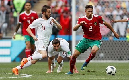 Soccer Football - World Cup - Group B - Portugal vs Morocco - Luzhniki Stadium, Moscow, Russia - June 20, 2018 Morocco's Achraf Hakimi in action with Portugal's Bernardo Silva and Cedric Soares REUTERS/Maxim Shemetov