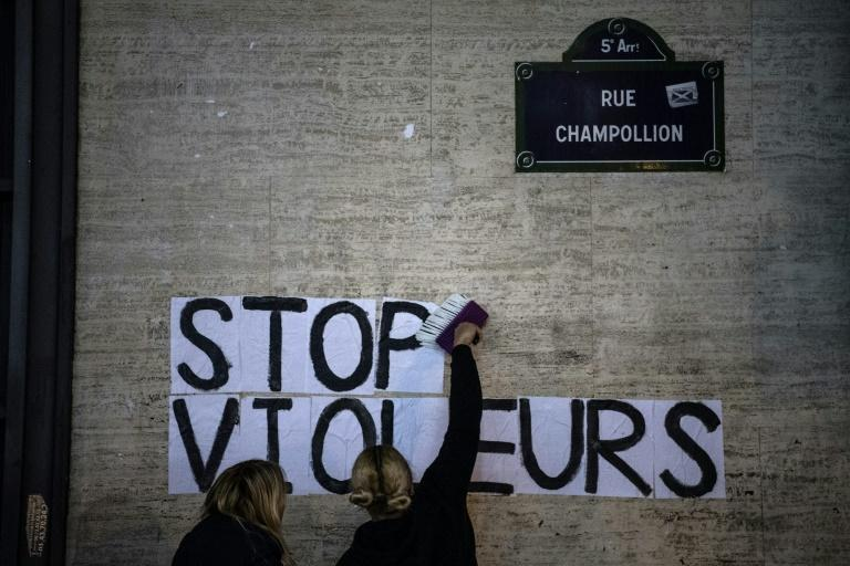"""""""Stop rapists"""": Demonstrators stuck a slogan on a wall in Paris close to where Roman Polanski's new film was showing"""
