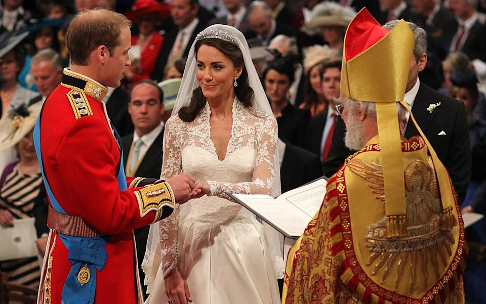 Prince William and Kate Middleton exchange rings in front of the Archbishop of Canterbury during their wedding at Westminster Abbey, on April 29, 2011  - AFP PHOTO / WPA POOL / Dominic Lipinski