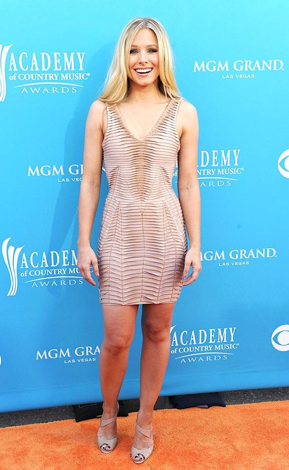 "We're still not quite sure why she was at the Academy of Country Music Awards, but Kristen Bell certainly set hearts afire in her pleated Herve Leger by Max Azria mini and matching peep-toes. Denise Truscello/<a href=""http://www.wireimage.com"" target=""new"">WireImage.com</a> - April 18, 2010"