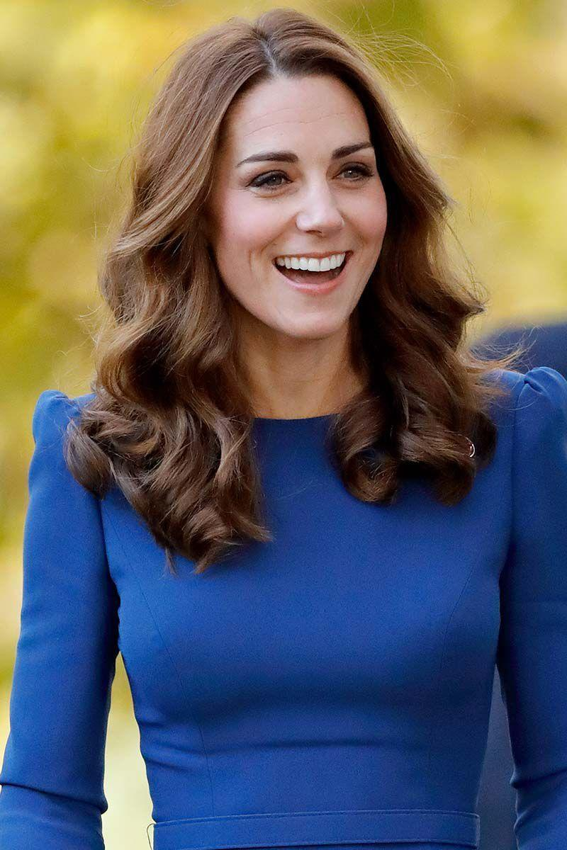 <p>Kate Middleton stepped out with her glossy hair parted down the middle and styled into her signature loose curls. </p>