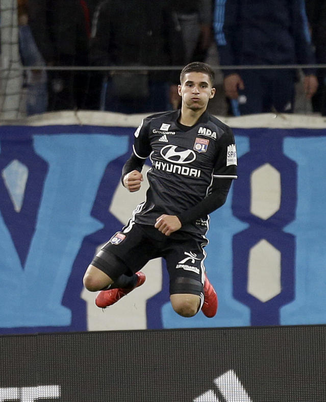 Lyon's Houssem Aouar, celebrates after scoring during the League One soccer match between Marseille and Lyon at the Velodrome stadium, in marseille, southern France , Sunday, March 18, 2018. (AP Photo/Claude Paris)