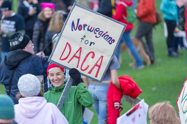<p>Referencing a scandal over Trump's immigration comments, the sign implies, Norwegian people in support for DACA program at Portland's National March for Impeachment on Jan. 20, 2018, in downtown Portland, Ore. (Photo: Diego Diaz/Icon Sportswire via Getty Images). </p>