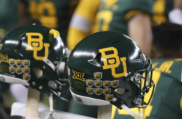 Baylor helmets on the bench in an NCAA college football game against West Virginia in Waco, Texas, Thursday, Oct. 31, 2019. (AP Photo/Jerry Larson)