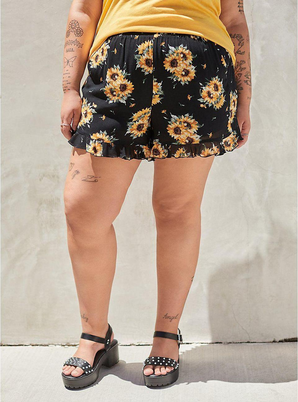 """<p>torrid.com</p><p><strong>$34.12</strong></p><p><a href=""""https://go.redirectingat.com?id=74968X1596630&url=https%3A%2F%2Fwww.torrid.com%2Fproduct%2Fruffle-hem-mid-short---gauze-sunflower-black-%2F13166414.html&sref=https%3A%2F%2Fwww.thepioneerwoman.com%2Ffashion-style%2Fg37083925%2Fbest-plus-size-shorts%2F"""" rel=""""nofollow noopener"""" target=""""_blank"""" data-ylk=""""slk:Shop Now"""" class=""""link rapid-noclick-resp"""">Shop Now</a></p><p>You can never have too many florals! Pair these cute sunflower-printed shorts with a bright yellow top for a look that is sure to get you smiling. </p>"""