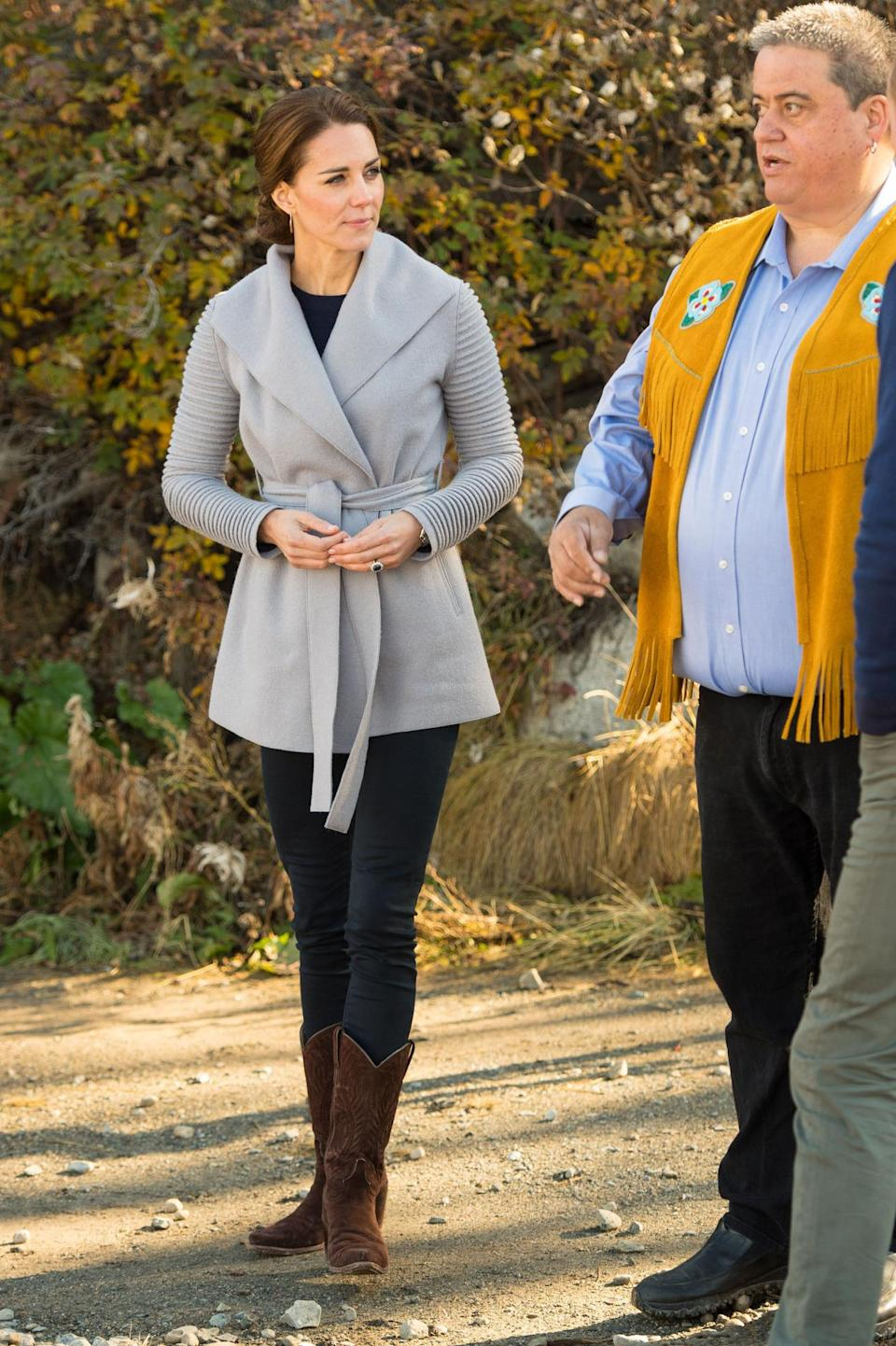 <p>Kate visited a small Canadian community, suitably choosing a grey wrap coat by Canadian brand, Sentaler. She paired the jacket with sensible brown cowboy boots and skinny jeans.</p><p><i>[Photo: PA]</i> </p>