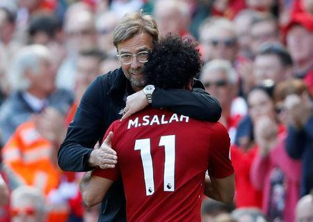 Soccer Football - Premier League - Liverpool vs Brighton & Hove Albion - Anfield, Liverpool, Britain - May 13, 2018 Liverpool's Mohamed Salah is hugged by manager Juergen Klopp as he is substituted Action Images via Reuters/Carl Recine