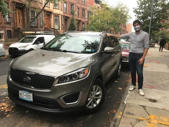 Julien Genestoux and his new car in Brooklyn, New York