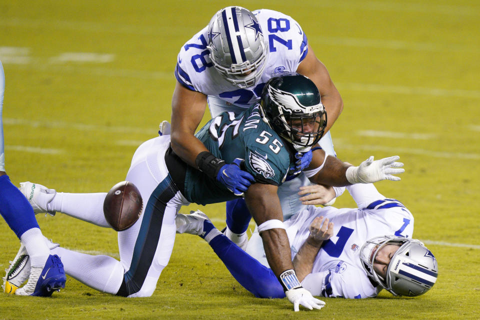 Dallas Cowboys quarterback Ben DiNucci (7) fumbles the ball after a hit by Philadelphia's Brandon Graham. (AP Photo/Chris Szagola)