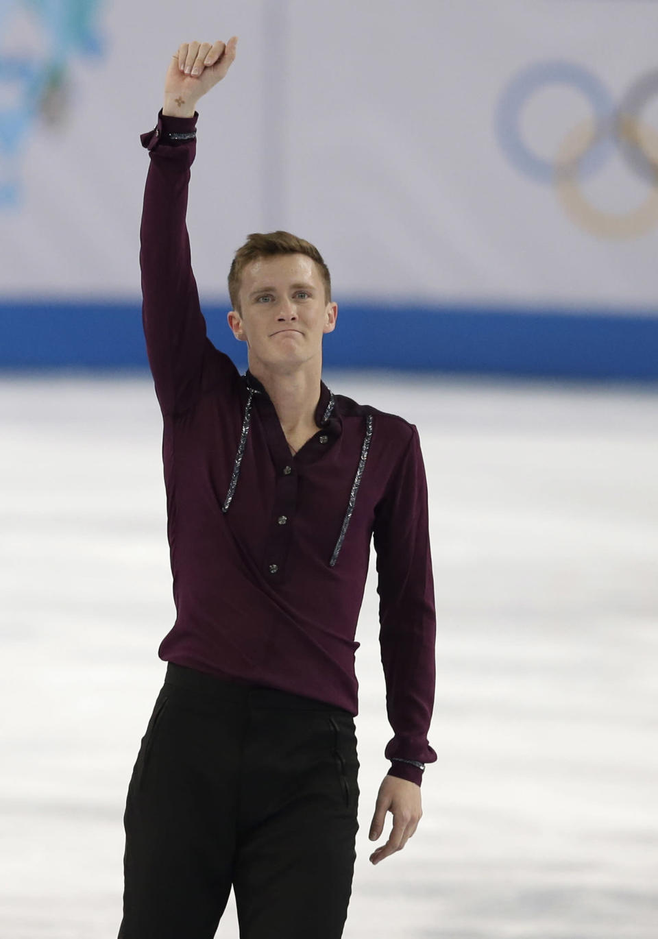 Jeremy Abbott of the United States gestures to the crowd after competing in the men's short program figure skating competition at the Iceberg Skating Palace during the 2014 Winter Olympics, Thursday, Feb. 13, 2014, in Sochi, Russia. (AP Photo/Darron Cummings)