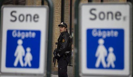 A policeman stands guard outside the central court in Oslo
