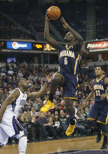 Indiana Pacers guard Lance Stephenson (6) dries to the basket against Sacramento Kings defender Marcus Thornton during the first half of an NBA basketball game in Sacramento, Calif., on Wednesday, Jan. 18, 2012. (AP Photo/Steve Yeater)
