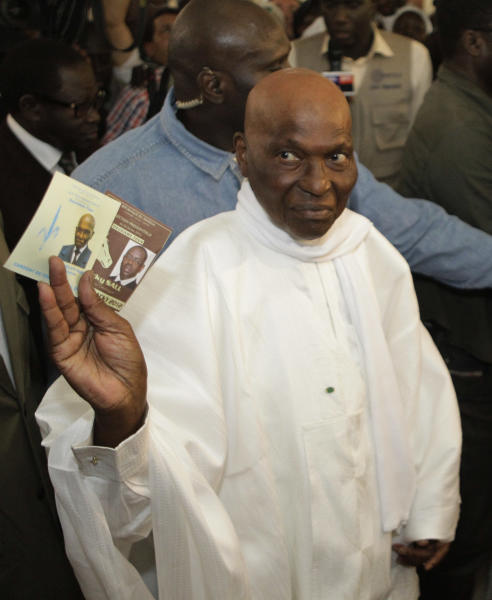 President Abdoulaye Wade holds up the ballot papers for himself and opponent Macky Sall as he prepares to cast his vote at a polling station in his home Point E neighborhood of Dakar, Senegal Sunday, March 25, 2012. Senegalese voters are deciding Sunday whether to give their 85-year-old president another term in office, or instead back his one-time protege in a runoff election that could oust the incumbent of 12 years.(AP Photo/Rebecca Blackwell)