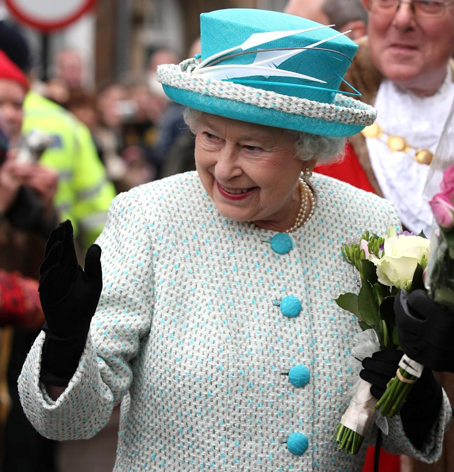 NORFOLK, ENGLAND - FEBRUARY 6: Queen Elizabeth II waves as she leaves Kings Lynn Town Hall on February 6, 2012 in Norfolk, England. Today is Accession Day, with the Queen celebrating 60 years to the day since she became Monarch. (Photo by Chris Radburn - WPA Pool/Getty Images)