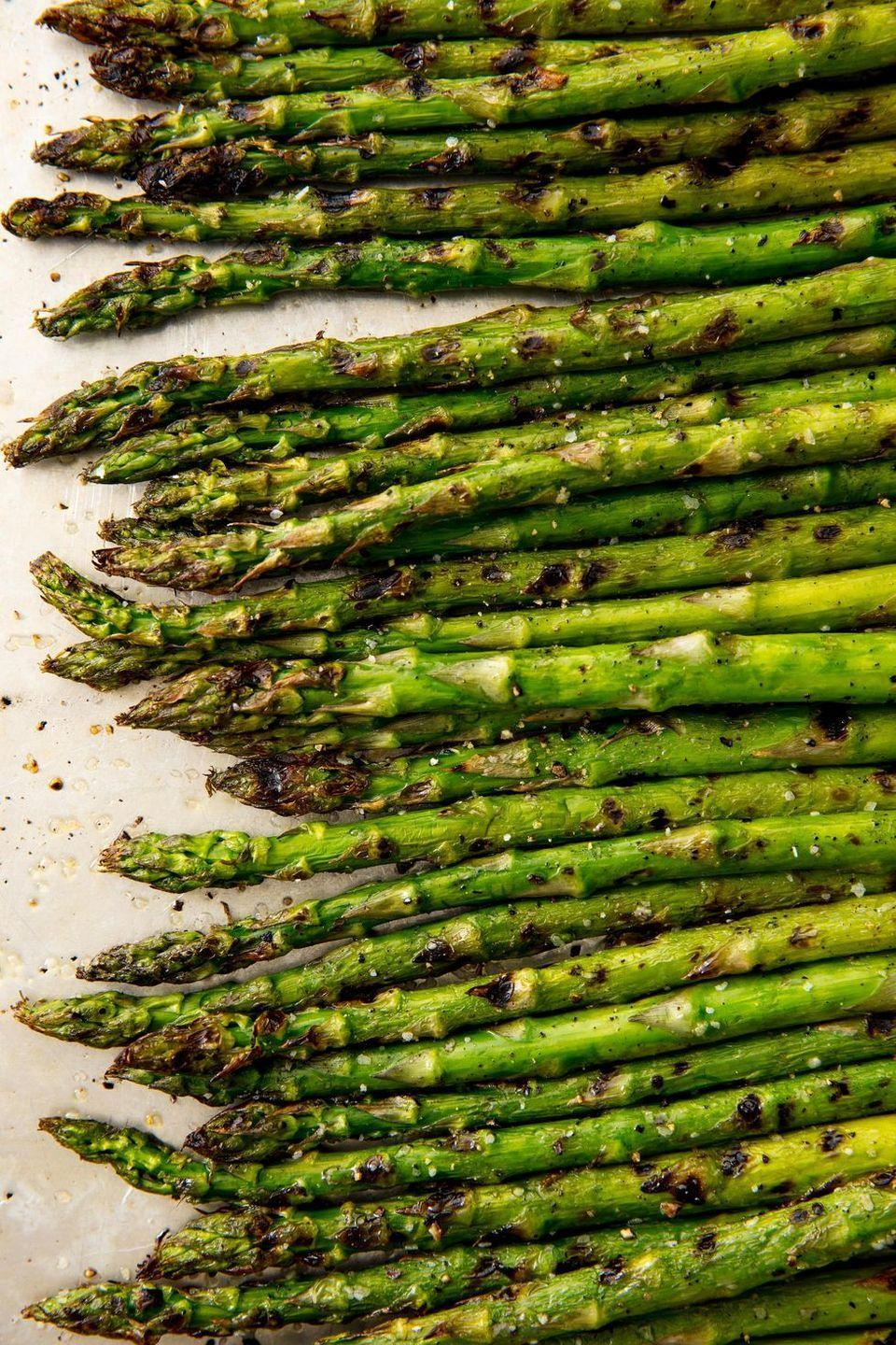 """<p>When it's nice out, always grill your vegetables. Those grill marks add SO. MUCH. FLAVOUR. And can make pretty much any green vegetable feel like less of a chore.</p><p>Get the <a href=""""https://www.delish.com/uk/cooking/recipes/a31802776/best-grilled-asparagus-recipe/"""" rel=""""nofollow noopener"""" target=""""_blank"""" data-ylk=""""slk:Grilled Asparagus"""" class=""""link rapid-noclick-resp"""">Grilled Asparagus</a> recipe.</p>"""