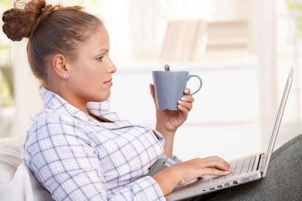 young female working at home in ...