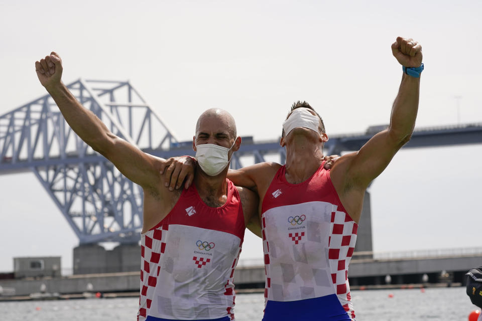 Martin Sinkovic and Valent Sinkovic of Croatia celebrate after winning the gold medal in the men's rowing pair final at the 2020 Summer Olympics, Thursday, July 29, 2021, in Tokyo, Japan. (AP Photo/Darron Cummings