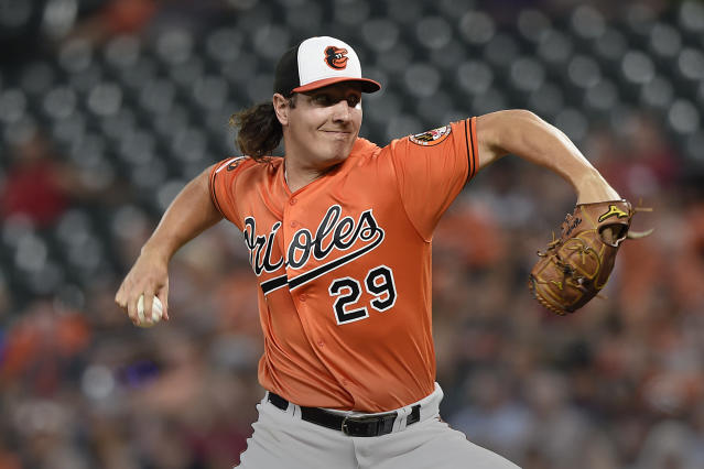 Baltimore Orioles pitcher Asher Wojciechowski throws against the Seattle Mariners in the first inning of a baseball game, Saturday, Sept. 21, 2019, in Baltimore. (AP Photo/Gail Burton)
