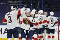 Florida Panthers defenseman Keith Yandle (3) and right wing Nikita Gusev (97)ref52 celebrate after the team defeated the Tampa Bay Lightning during an NHL hockey game Saturday, April 17, 2021, in Tampa, Fla. (AP Photo/Chris O'Meara)