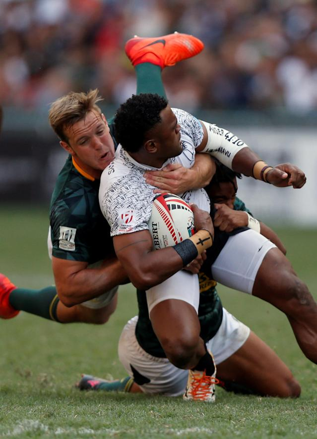 Rugby Union - Fiji v South Africa - World Rugby Sevens Series - Hong Kong Stadium, Hong Kong, China - April 8, 2018 - Fiji's Amenoni Nasilasila is tackled by South Africa's Heino Bezuidenhout. REUTERS/Bobby Yip