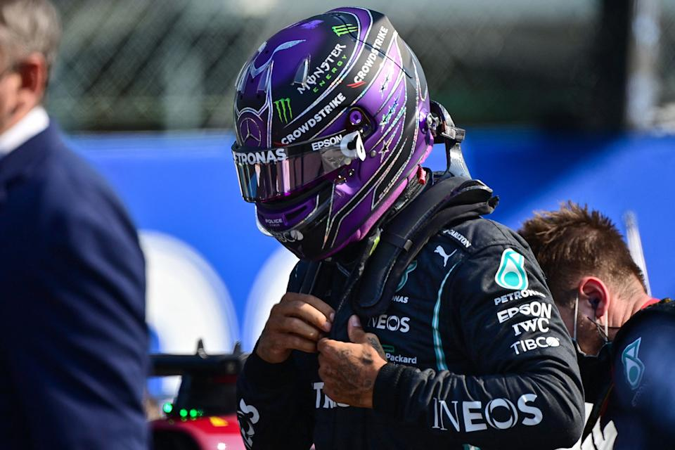 Mercedes' British driver Lewis Hamilton gets ready prior to the sprint session at the Autodromo Nazionale circuit in Monza, on September 11, 2021, ahead of the Italian Formula One Grand Prix. (Photo by ANDREJ ISAKOVIC / AFP) (Photo by ANDREJ ISAKOVIC/AFP via Getty Images)