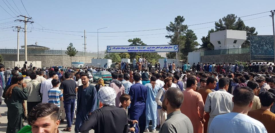 KABUL, AFGHANISTAN - AUGUST 16: Afghans crowd at the tarmac of the Kabul airport on August 16, 2021, to flee the country as the Taliban were in control of Afghanistan after President Ashraf Ghani fled the country. (Photo by Sayed Khodaiberdi Sadat/Anadolu Agency via Getty Images)