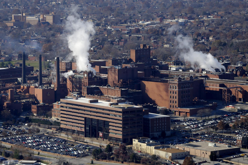 FILE - In this Tuesday, Nov. 25, 2014 file aerial photo, the Anheuser-Busch brewing complex is seen in St. Louis, Mo. A Wisconsin judge on Friday, May 24, 2019, ordered Anheuser-Busch to stop suggesting in advertising that MillerCoors' light beers contain corn syrup, wading into a fight between two beer giants that are losing market share to small independent brewers. (AP Photo/Charlie Riedel, File)