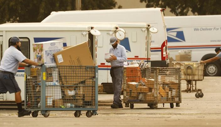 VAN NUYS, CA - SEPTEMBER 09: Mail carriers load their trucks at the United States Postal Service (USPS) located at 15701 Sherman Way in Van Nuys, California on the morning of September 9, 2020. The USPS may be experiencing delays. U.S. Postal Service on Wednesday, Sept. 9, 2020 in Van Nuys, CA. (Al Seib / Los Angeles Times