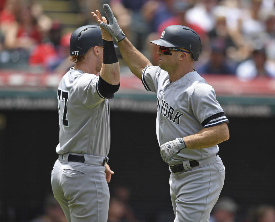 New York Yankees' Brett Gardner, right, is congratulated by Clint Frazier after hitting a 2-run home run off Cleveland Indians starting pitcher Shane Bieber in the second inning of a baseball game, Sunday, June 9, 2019, in Cleveland. (AP Photo/David Dermer)