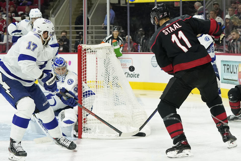 Tampa Bay Lightning goaltender Andrei Vasilevskiy (88) and left wing Alex Killorn (17) defend the goal against Carolina Hurricanes center Jordan Staal (11) during the second period in Game 5 of an NHL hockey Stanley Cup second-round playoff series in Raleigh, N.C., Tuesday, June 8, 2021. (AP Photo/Gerry Broome)