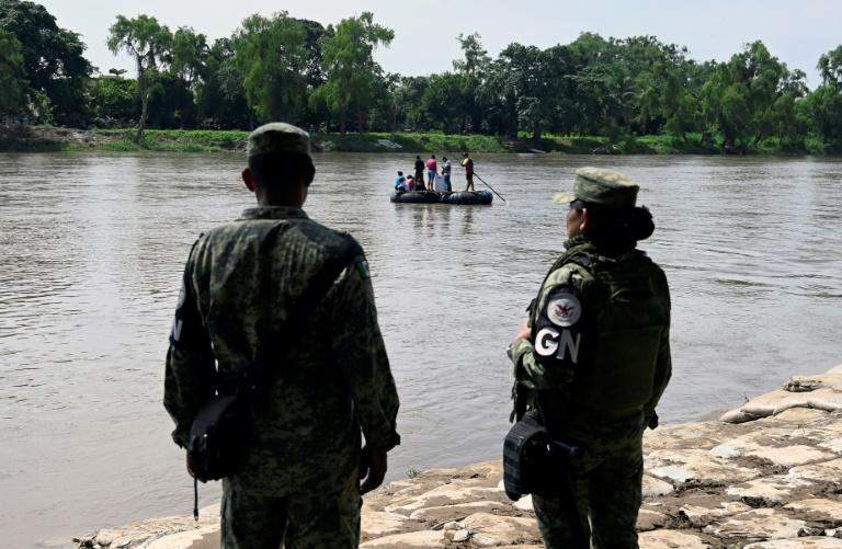 Mexican National Guard members (pictured July 2019) stand guard along the banks of the Suchiate river in Ciudad Hidalgo, Chiapas State, to prevent illegal crossings Guatemala (AFP Photo/ALFREDO ESTRELLA)