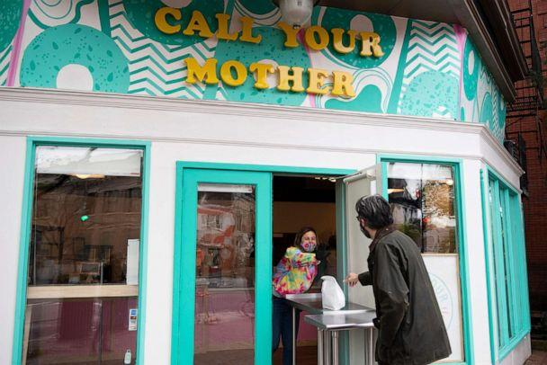 PHOTO: A person picks up his order from the new Call Your Mother deli during its opening in Capitol Hill iN Washington, D.C., on April 15, 2020. (Caroline Brehman/CQ Roll Call via Newscom)
