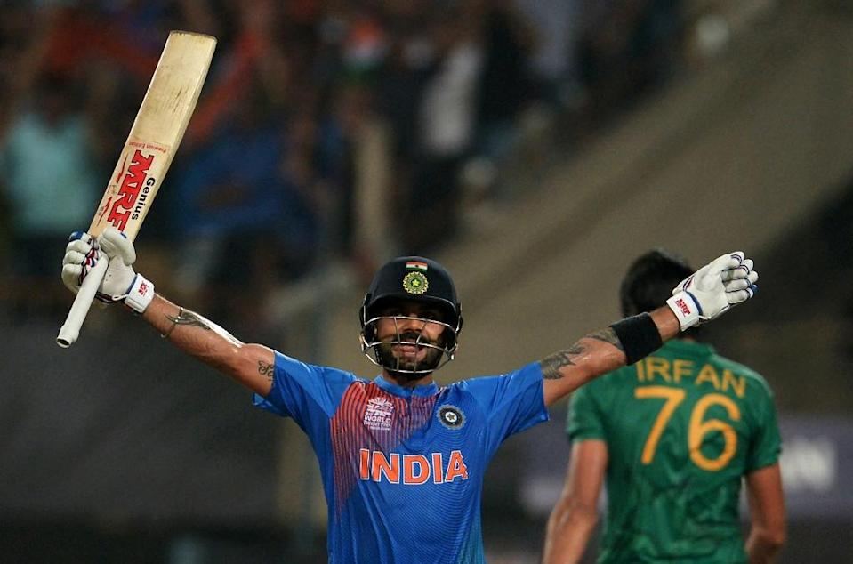 India's Virat Kohli celebrates after victory in the World T20 cricket tournament match between India and Pakistan at The Eden Gardens Cricket Stadium in Kolkata on March 19, 2016 (AFP Photo/Dibyangshu Sarkar)