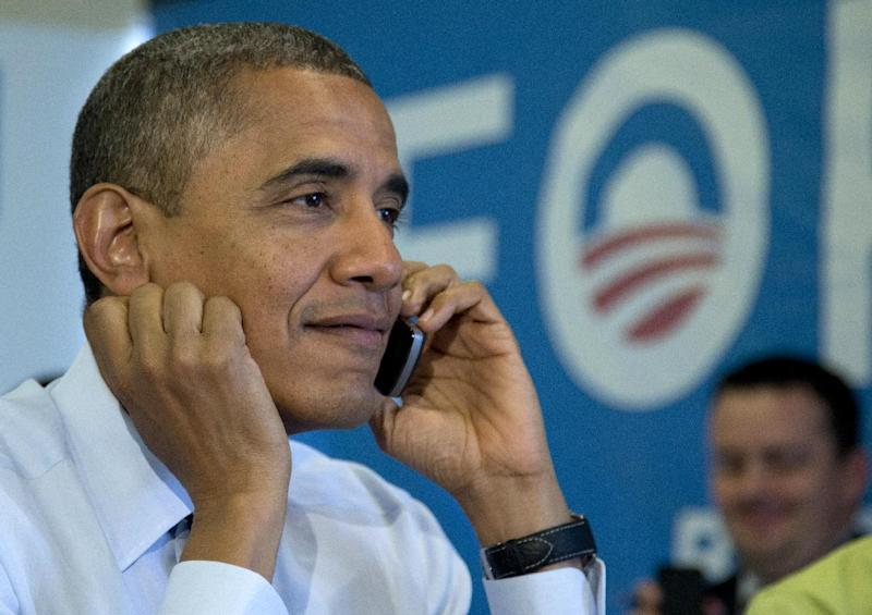 President Barack Obama calls Wisconsin volunteers as he visits a campaign office call center the morning of the 2012 election, Tuesday, Nov. 6, 2012, in Chicago. (AP Photo/Carolyn Kaster)