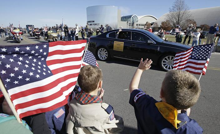 David Thatcher, one of the four surviving members of the 1942 raid on Tokyo led by Lt. Col. Jimmy Doolittle, waves from a car as he arrives at the National Museum of the US Air Force, Saturday, Nov. 9, 2013, in Dayton, Ohio. Three of the four surviving members of the WWII raid came for a final toast in the evening. (AP Photo/Al Behrman)