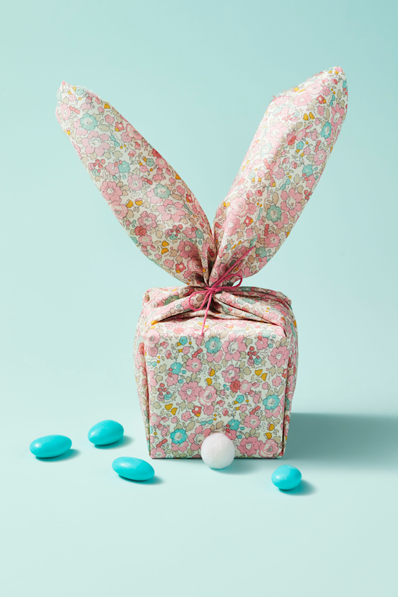 """<p>If you really want to keep their treats and trinkets under wraps, stuff them inside a box and wrap it up like a bunny, pompom tail and all. </p><p><strong>RELATED: </strong><a href=""""https://www.goodhousekeeping.com/holidays/easter-ideas/g711/easter-spring-crafts/"""" rel=""""nofollow noopener"""" target=""""_blank"""" data-ylk=""""slk:Fun Easter Crafts That Anyone Can Do"""" class=""""link rapid-noclick-resp"""">Fun Easter Crafts That Anyone Can Do</a></p>"""
